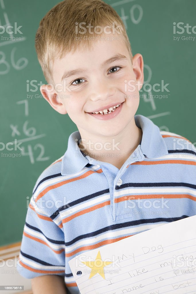 Proud student holding paper with star royalty-free stock photo