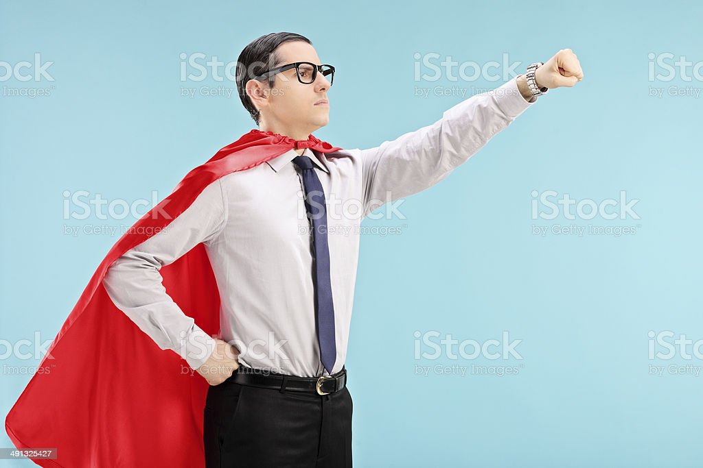 Proud superhero with gripped fist stock photo