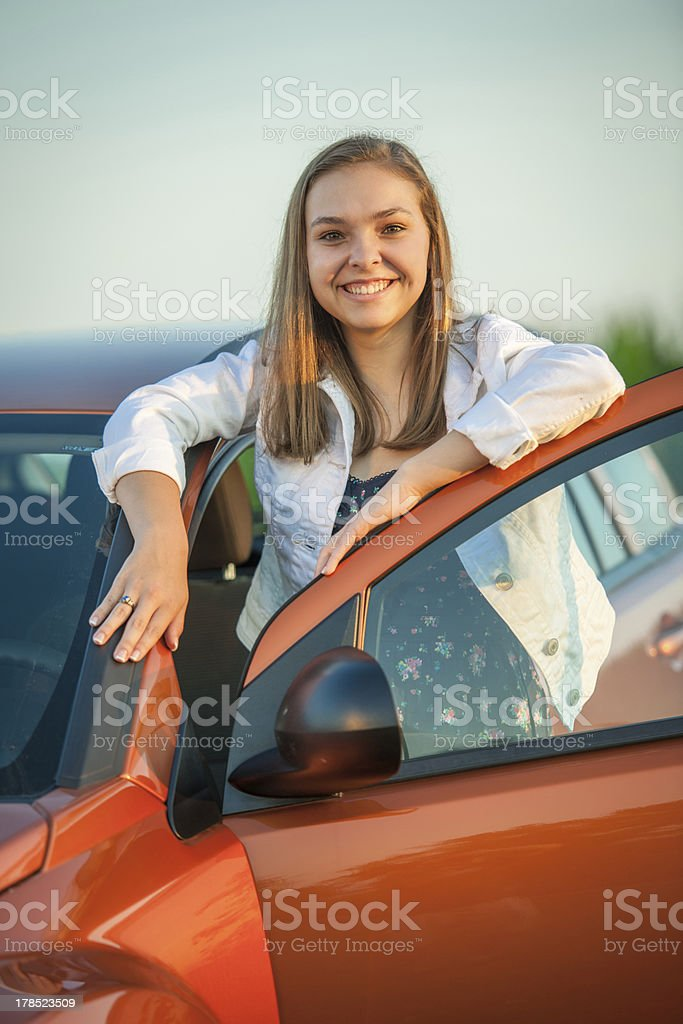 Proud teen with her new car stock photo