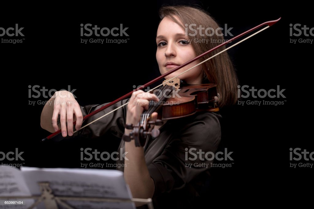 proud violinist woman with her violin and bow stock photo