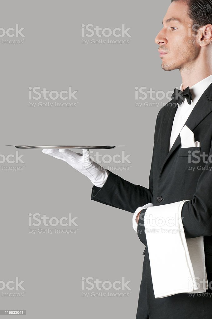 Proud waiter serving with tray royalty-free stock photo
