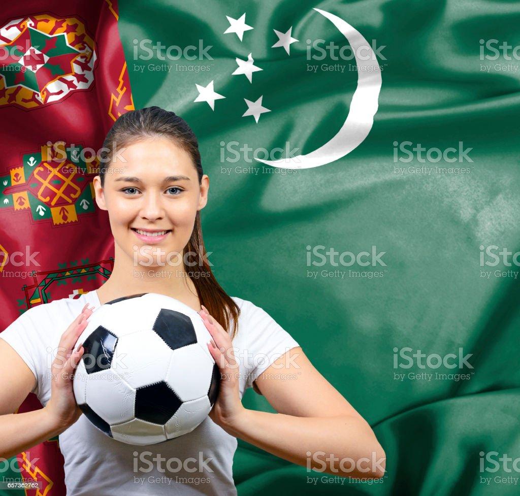 Proud woman football fan of Turkmenistan stock photo