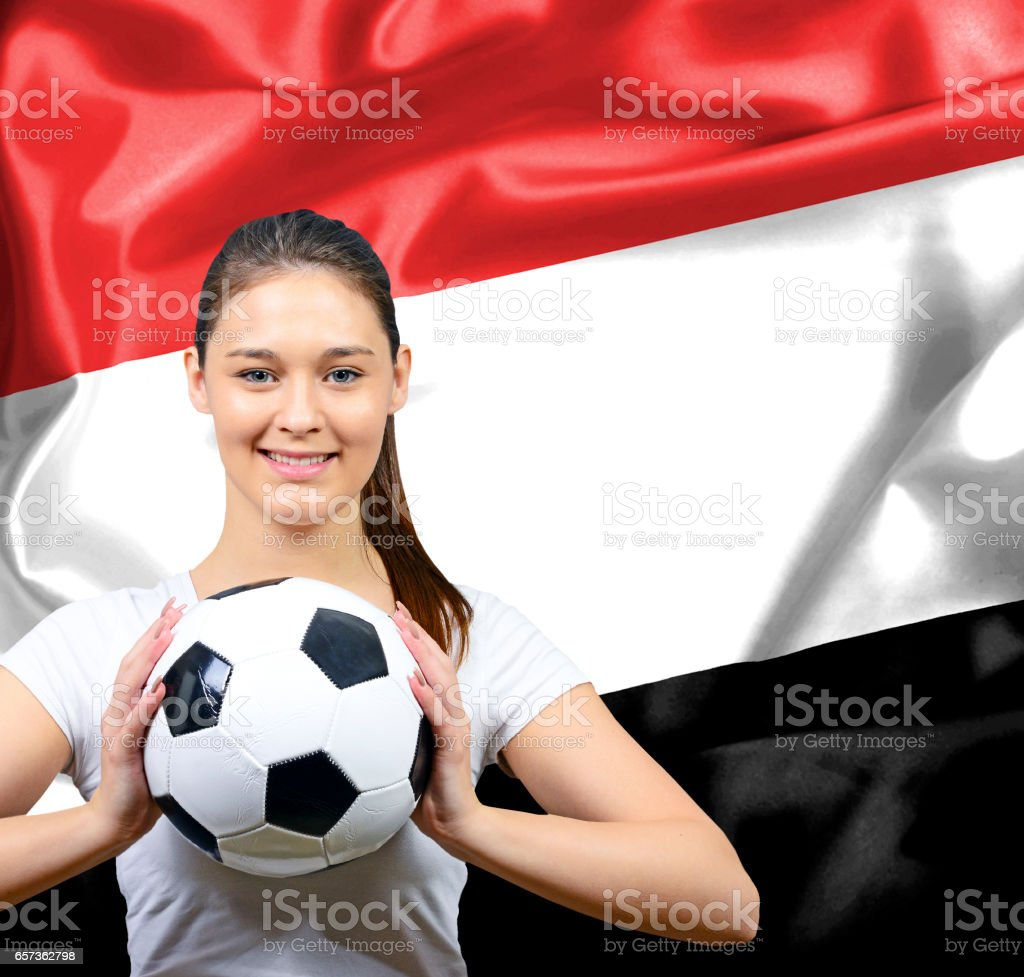 Proud woman football fan of Yemen stock photo