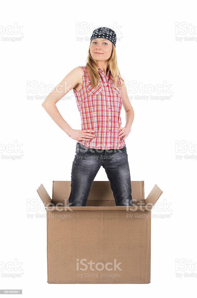Proud woman standing in a cardboard box royalty-free stock photo