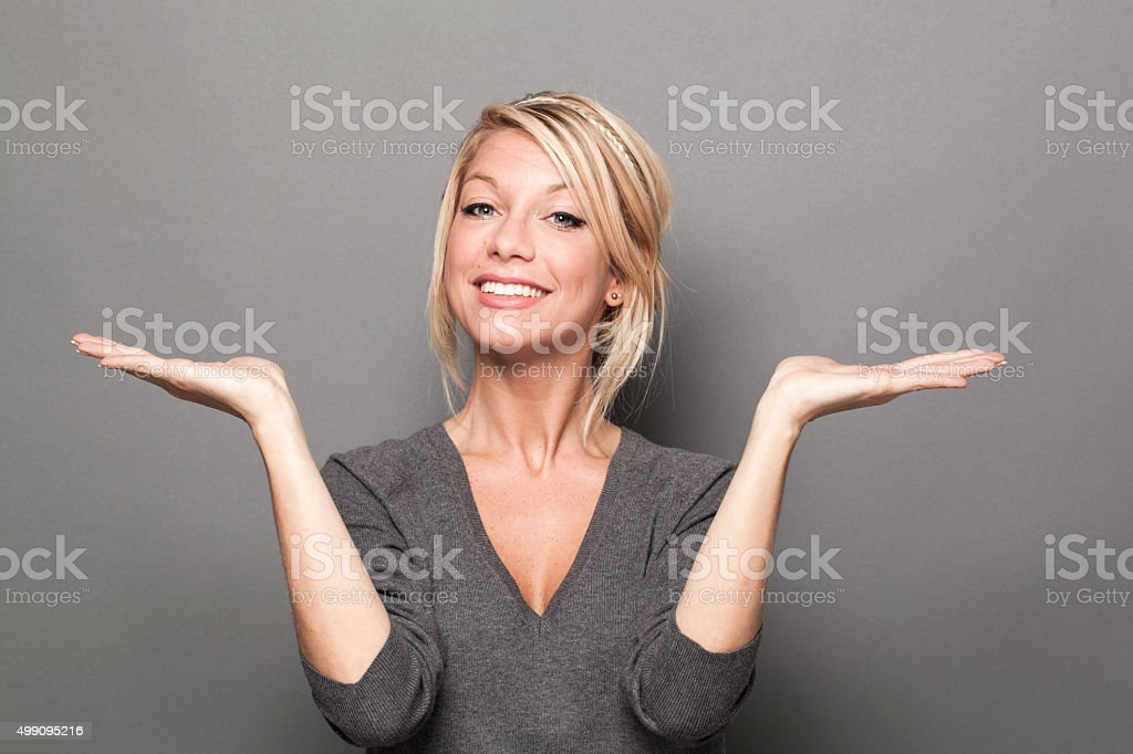 proud young woman displaying equal solutions of product or service stock photo
