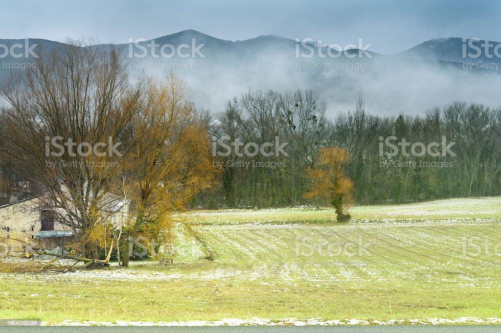 Provencal farmhouse in winter mist, France stock photo