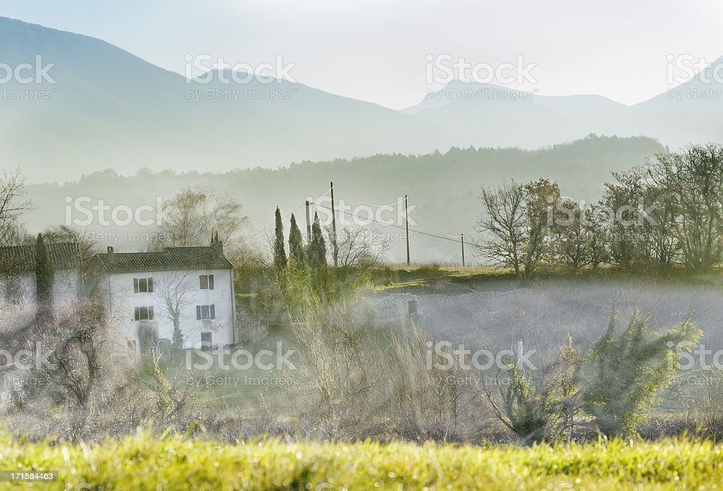 Provencal farmhouse in winter mist, France royalty-free stock photo