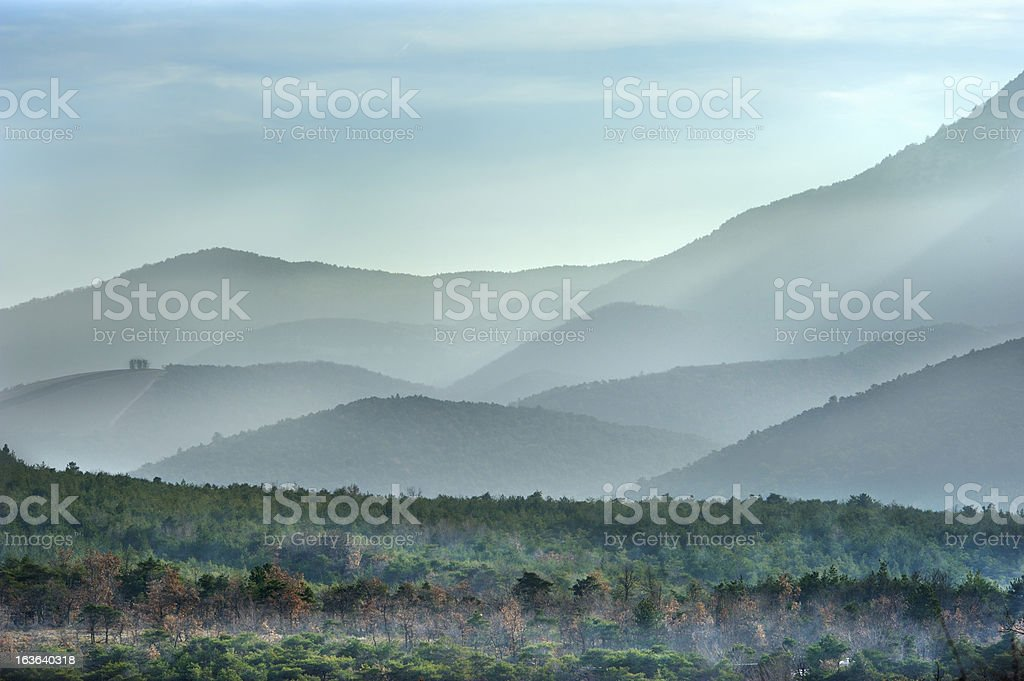 Provencal mountains in winter mist, France stock photo