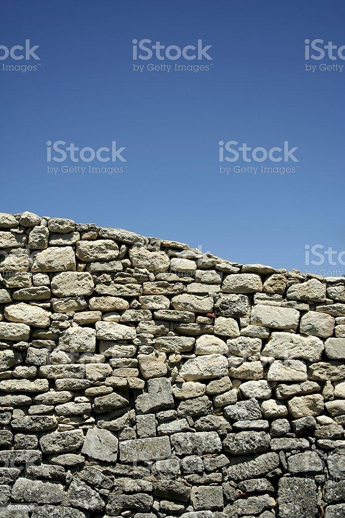 provencal stone wall blue sky royalty-free stock photo