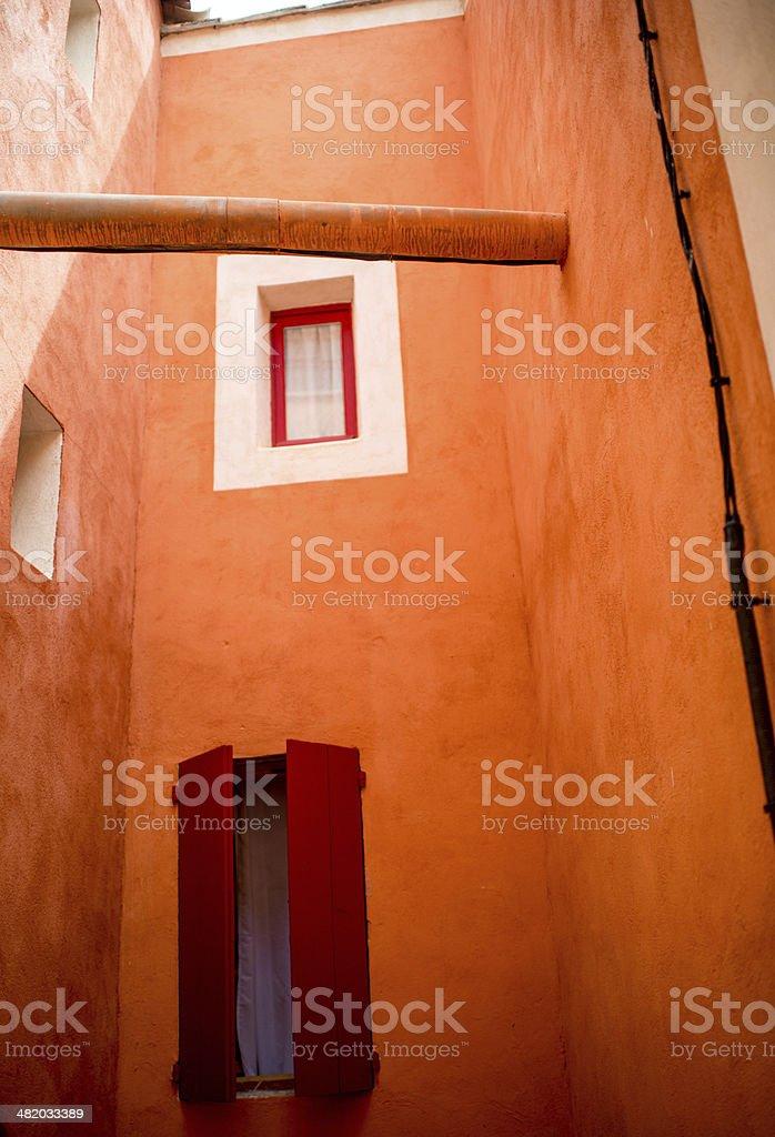 Provence windows on orange wall stock photo