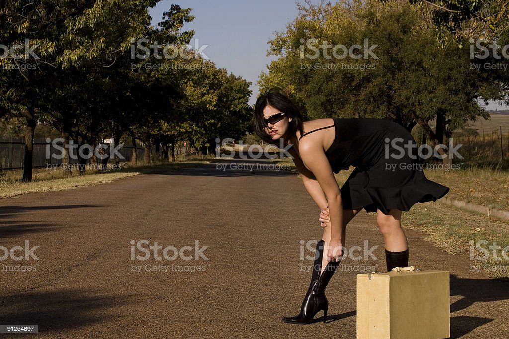 Provocative brunette boots royalty-free stock photo