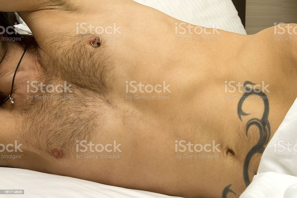 Provocatively Hiding Under Sheets stock photo