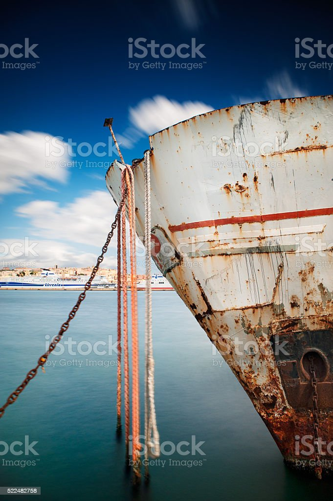 Prow of a ship wreck in the harbor- long exposure stock photo