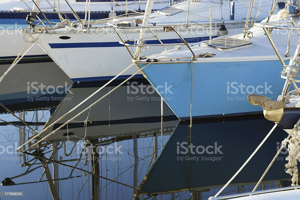 Prows of sailboats on the sea royalty-free stock photo