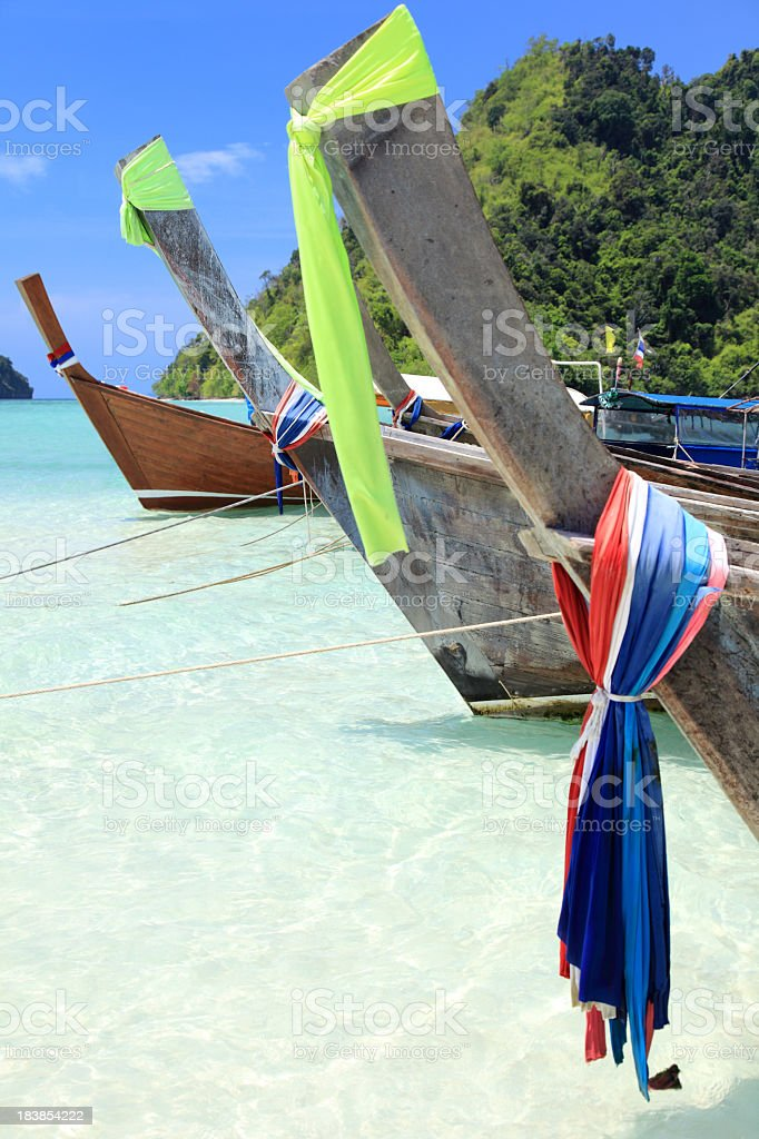 Prows of the long tail wooden boats stock photo