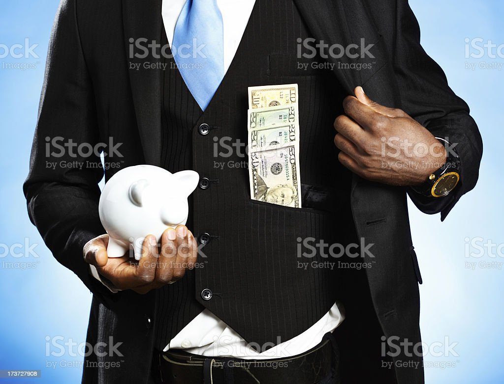 Prudent businessman saves two ways! royalty-free stock photo