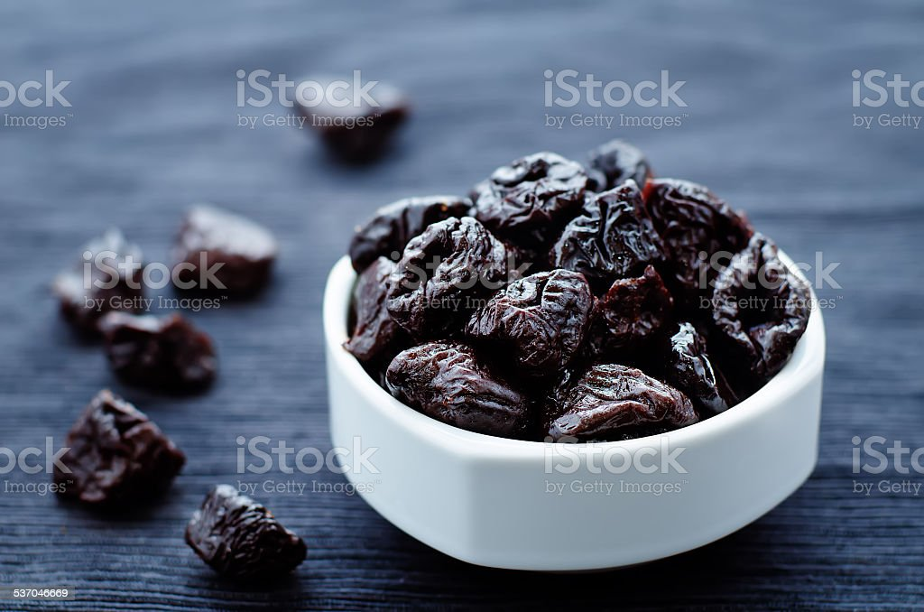 prunes in a bowl stock photo