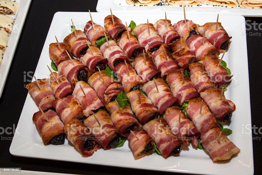 Prunes in bacon stock photo