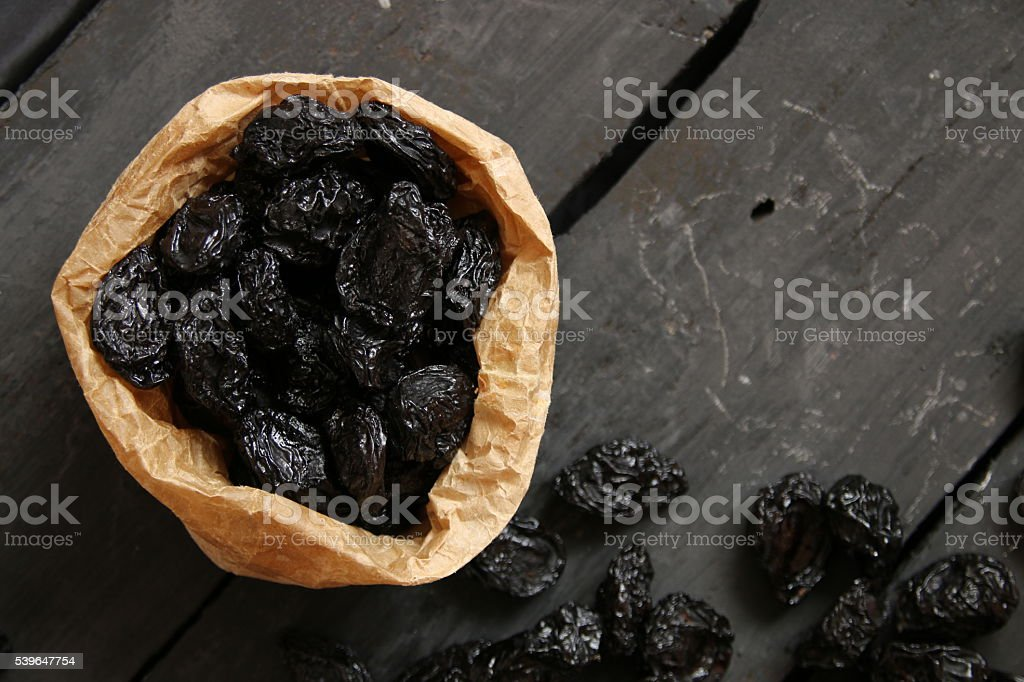 prunes on a dark table, food background stock photo