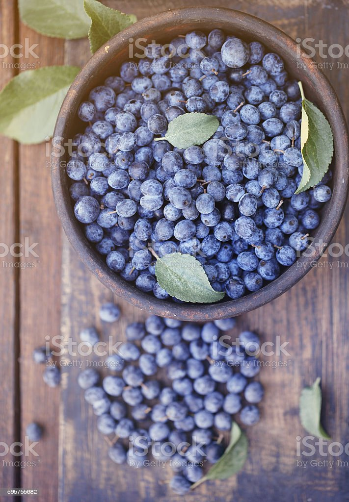 Prunus on a wooden board, top view stock photo