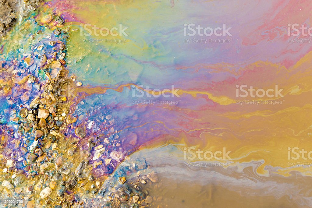 Psychedelic Abstract of Toxic Oil Pollution on Water stock photo