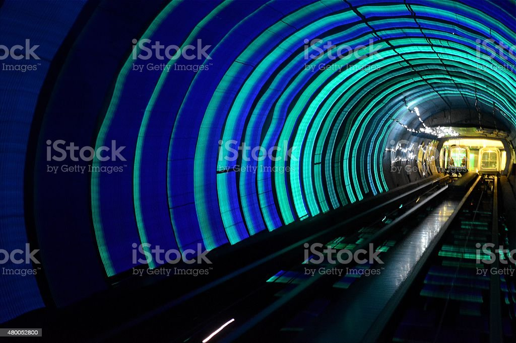 Abstract psychedelic light along tunnel train track.