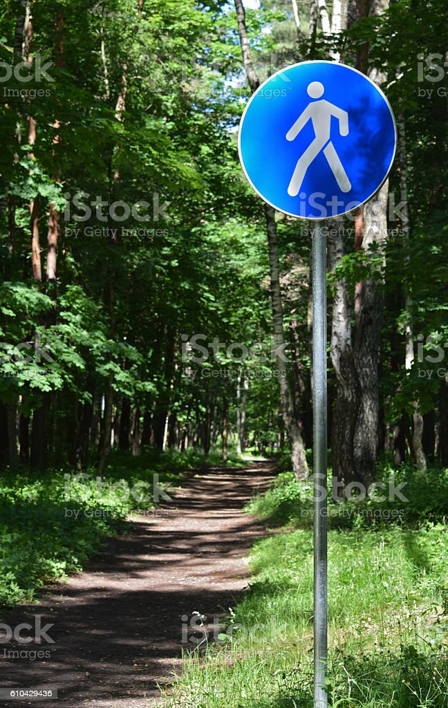 Psychedelic walking path sign stock photo