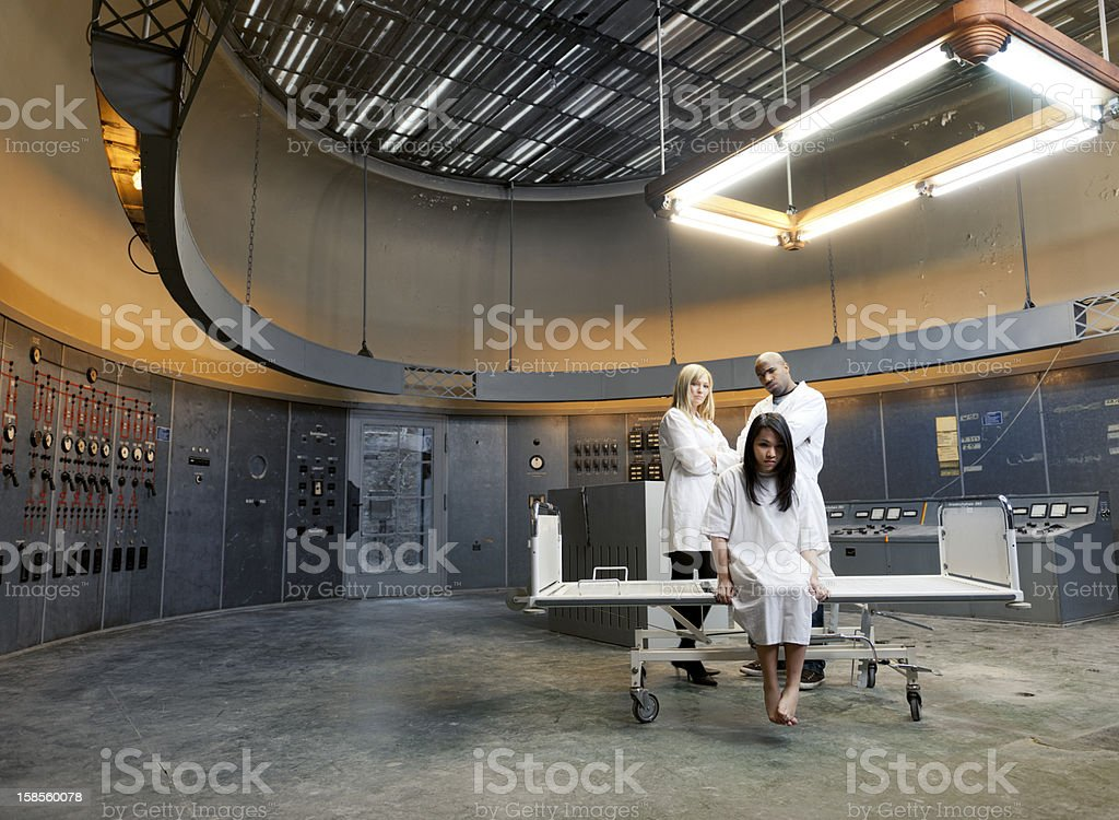 psychiatric patient and nurses in surreal environment royalty-free stock photo