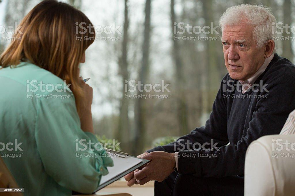 Psychiatrist and her elder patient stock photo