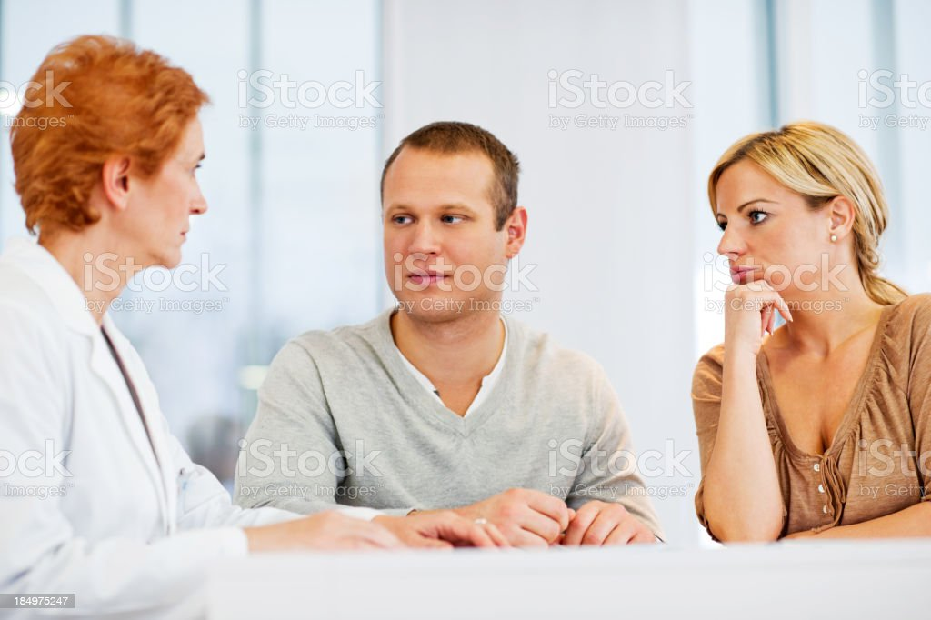 Psychiatrist talking with a couple. royalty-free stock photo