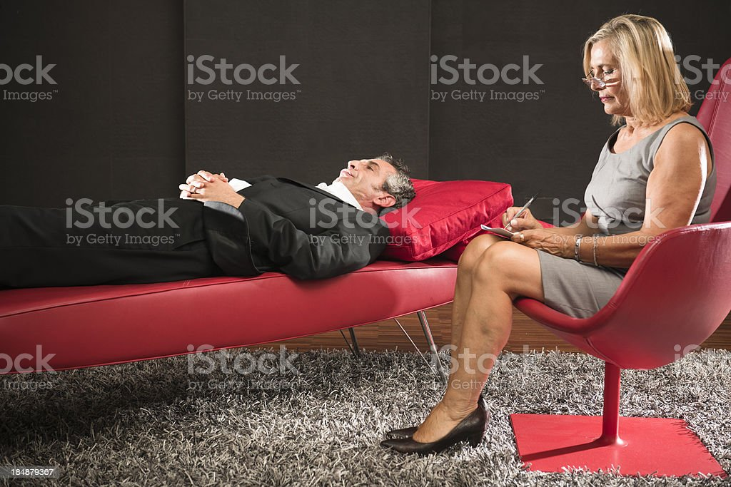 Psychiatrist Therapy on red sofa stock photo
