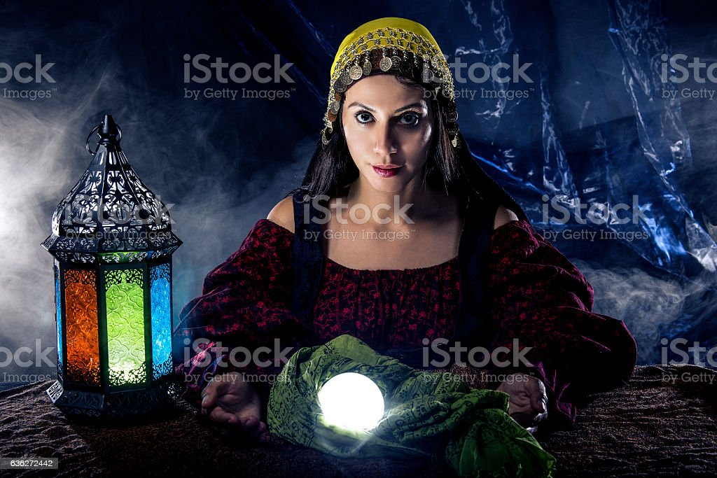 Psychic Reading with Crystal Ball and Fortune Teller stock photo