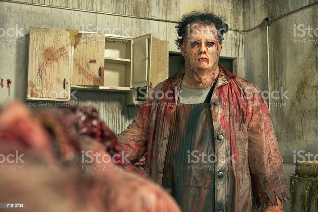 Psycho Butcher in his deadly kitchen stock photo