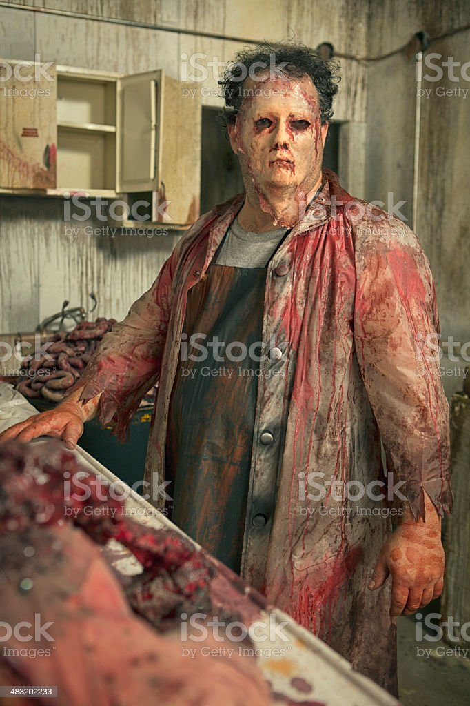 Psycho Butcher in his deadly kitchen royalty-free stock photo