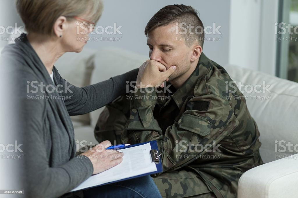 Psychologist and despair soldier stock photo