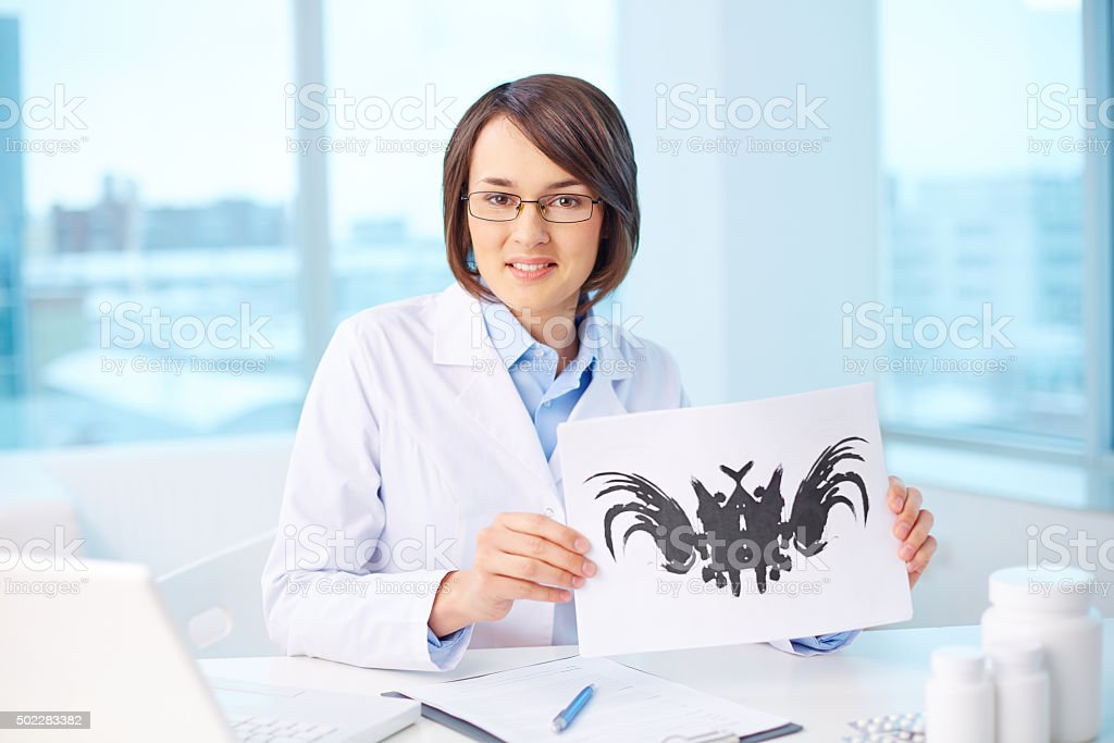 Psychologist at workplace stock photo