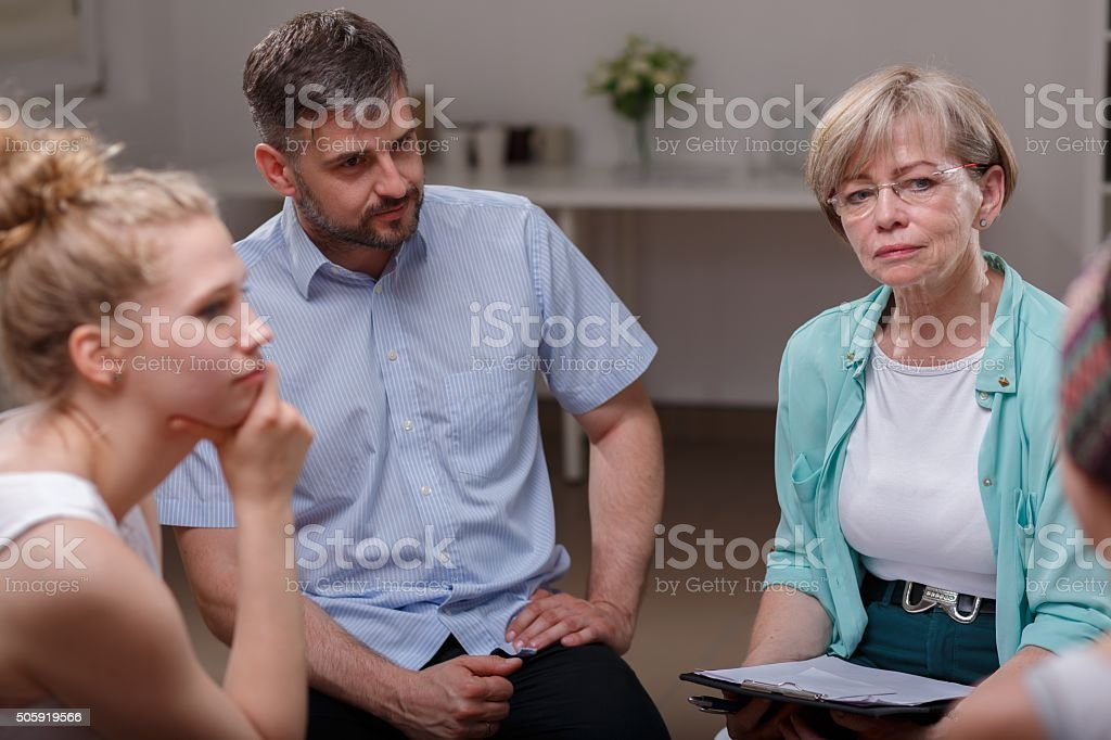 Psychologist listening member of group stock photo