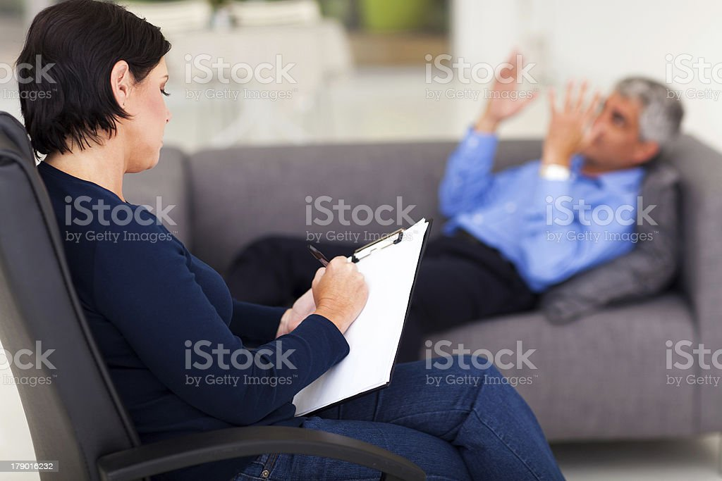 psychologist with patient royalty-free stock photo