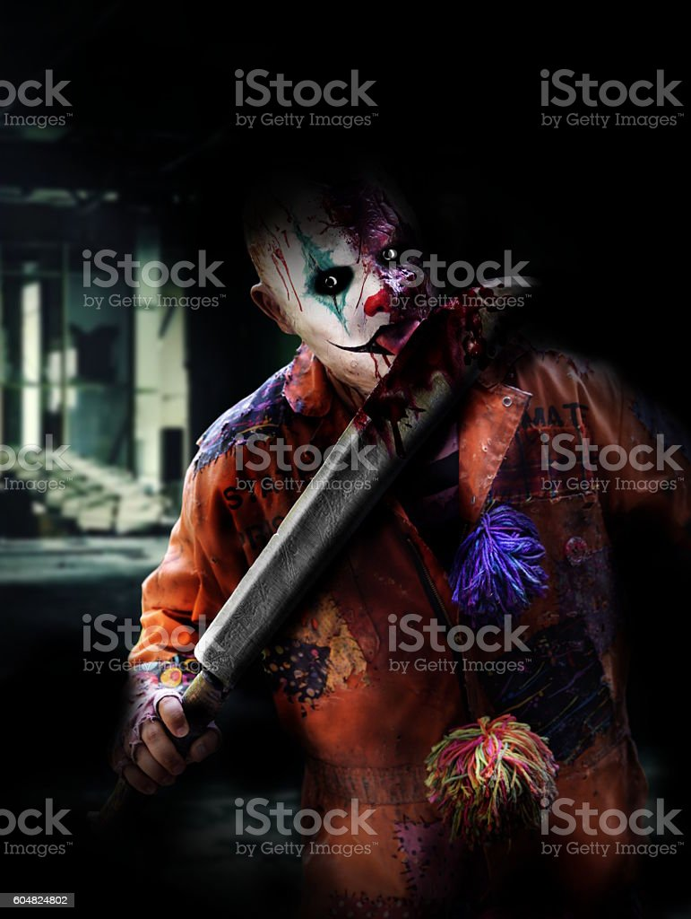 psychopath clown in horror house stock photo