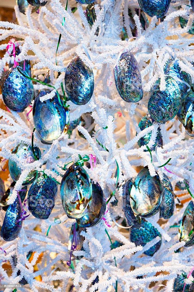 Pāua shells in a Christmas tree stock photo