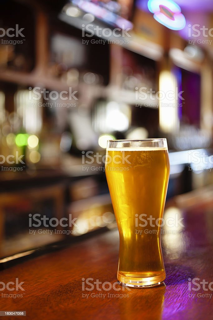 Pub Beer Glass on a Tavern Bar royalty-free stock photo