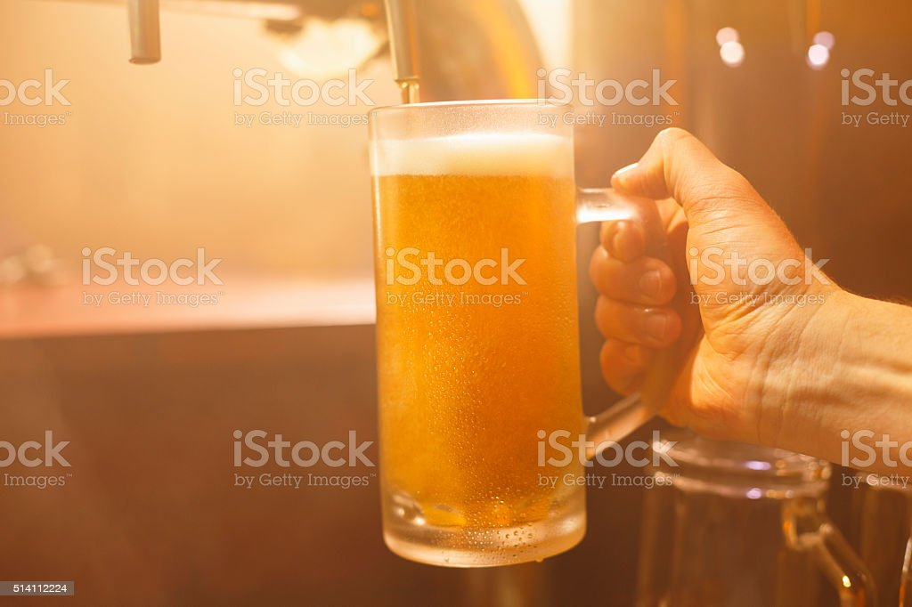 Pub Pouring a glass of  beer stock photo