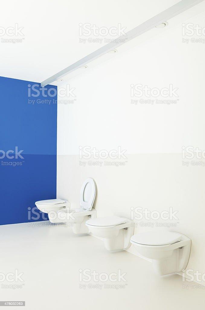 public bathroom, toilets in a row royalty-free stock photo
