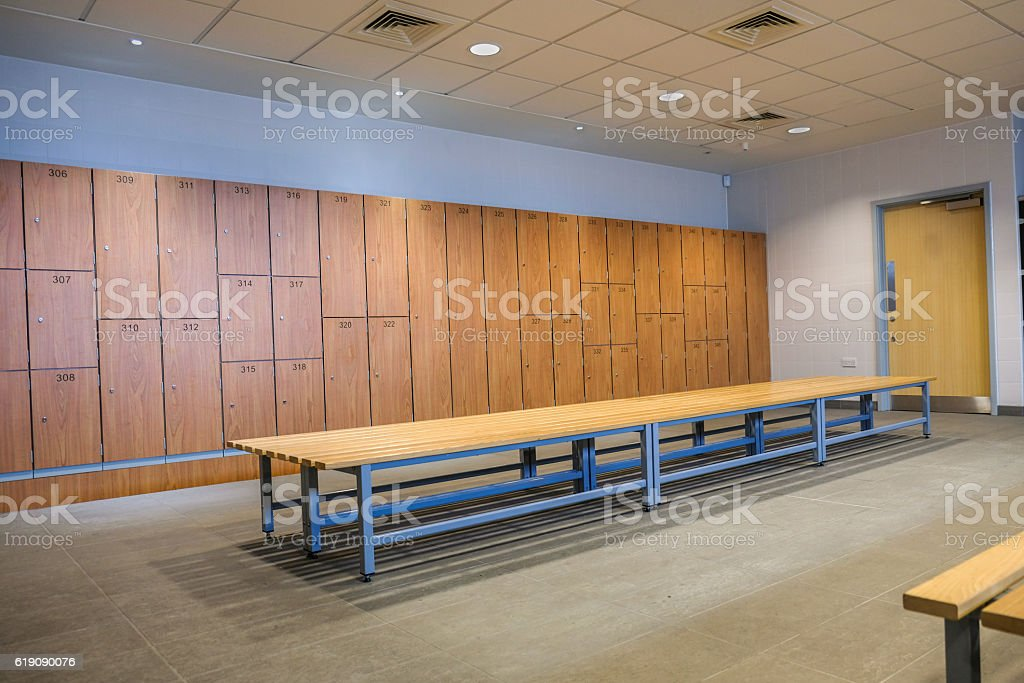 Public changing rooms with bench and lockers stock photo