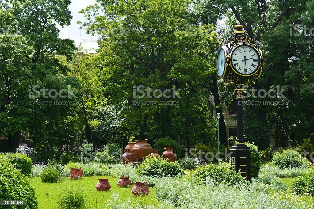 public clock and decorative in the Cismigiu Park stock photo