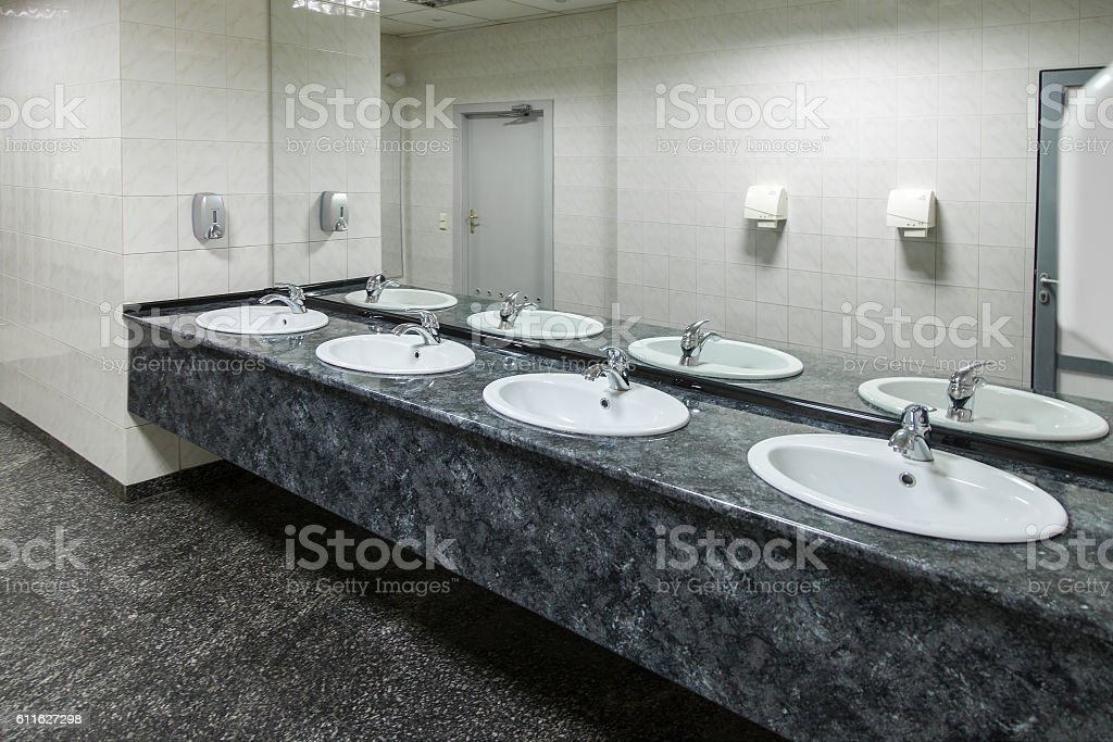 Public empty restroom stock photo