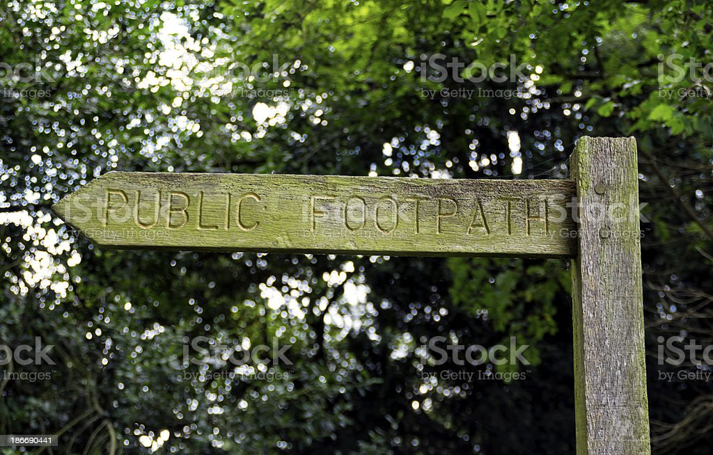 Public footpath sign in woodland royalty-free stock photo