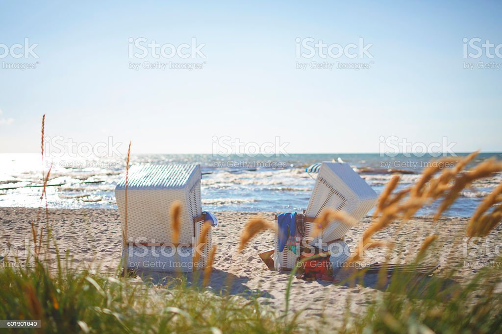 Public Hooded Beach Chair by the water stock photo