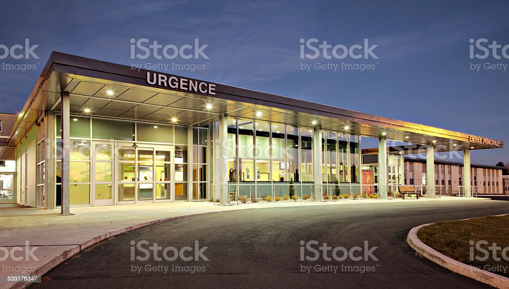 Public hospital emergency entrance driveway with French sign stock photo