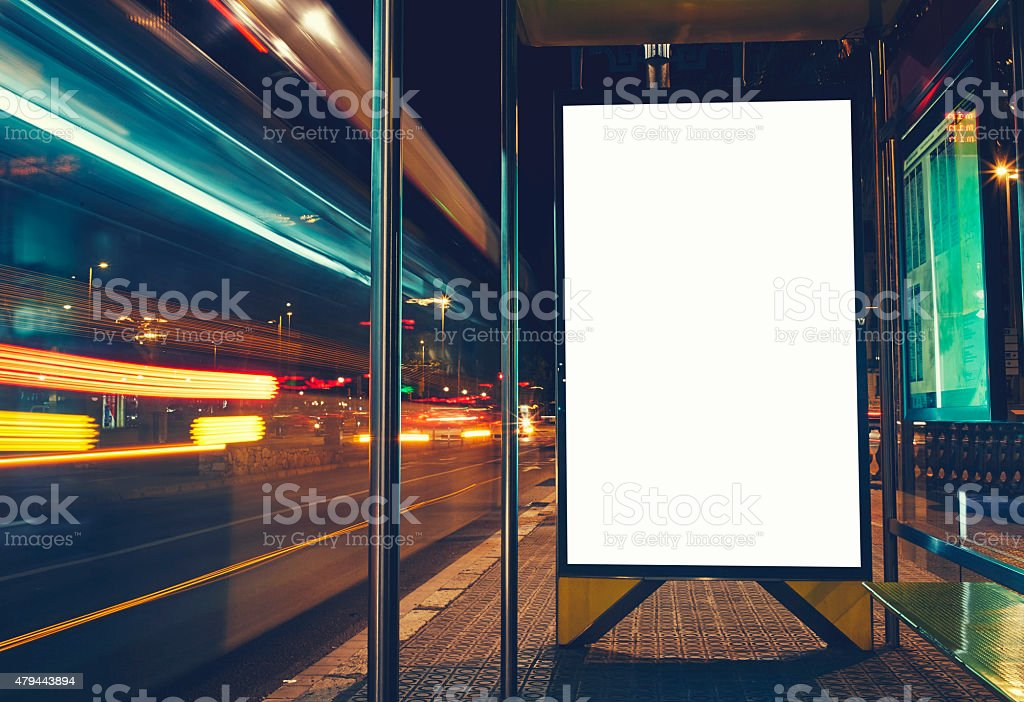 Public information board with blurred vehicles in high speed stock photo